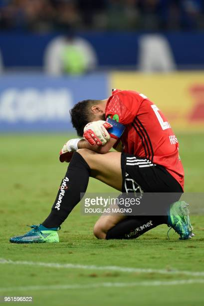 The goalkeeper of Chile's Universidad de Chile Johnny Herrera reacts after receiving a goal during the Copa Libertadores football match against...