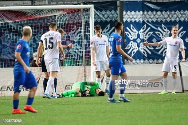 ZAPORIZHZHIA UKRAINE The goalkeeper of FC Zorya Luhansk secures the ball during the Ukrainian Premier League Matchday 21 game against PFC Lviv in...