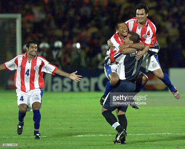 The goalkeeper of Paraguayan selection Jose Luis Chilavert is congratulated by his teammates after theif secound goal 07 October 2000 during the...