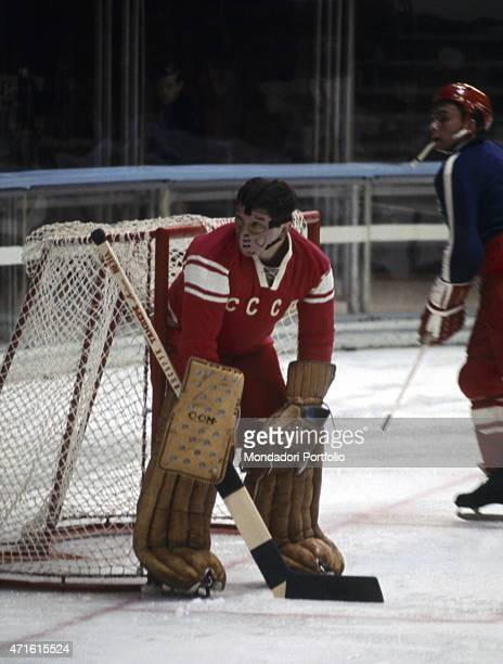 The goalkeeper of the Soviet ice hockey team waiting in front of the goal post during the VII Olympic Winter Games Cortina d'Ampezzo 1956