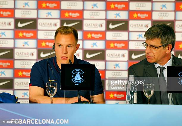 the goalkeeper with the vicepresident Jordi Mestre during the presentation of Ter Stegen new player of FC Barcelona in the offices of the club May 22...