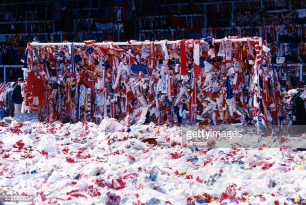 The goalmouth on the pitch at Anfield covered with Liverpool and Everton scarves and flags as a mark of respect to the many Liverpool fans who lost...