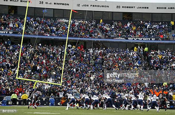 The goalpost tips after being blown by high winds during the game between the Buffalo Bills and the New England Patriots at Ralph Wilson Stadium...