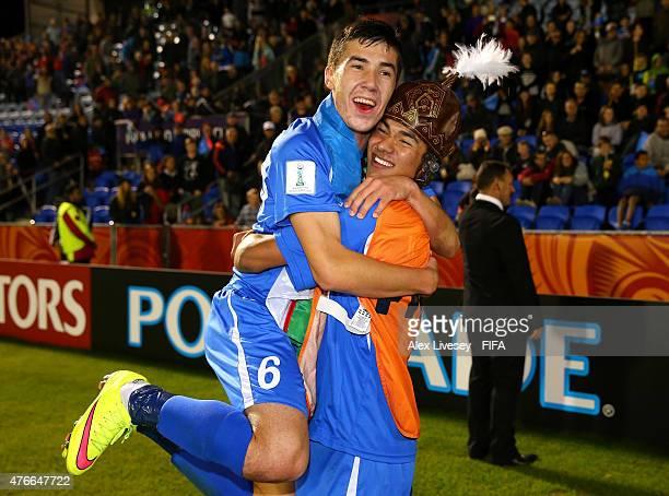 The goalscorer Dostonbek Khamdamov of Uzbekistan celebrates with Akramjon Komilov after victory over Austria in the FIFA U20 World Cup round of 16...