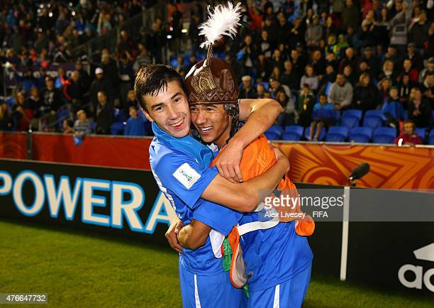 The goalscorer Dostonbek Khamdamov of Uzbekistan celebrates with Akramjon Komilov after victory over Austria in the FIFA U20 World Cup round of 16...