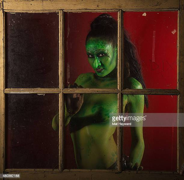 The Goblin of Super Geek League poses for a photo behind a window before performing durng Crash at El Corazon on July 10 2015 in Seattle Washington