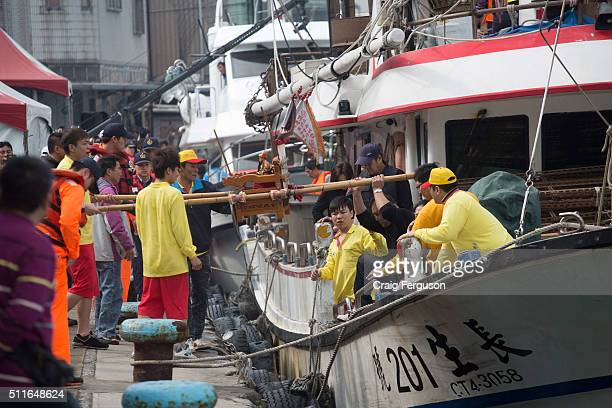 The God icon housed in a small palanquin is carried off a fishing boat during an annual religious event The rituals are intended to offer protection...