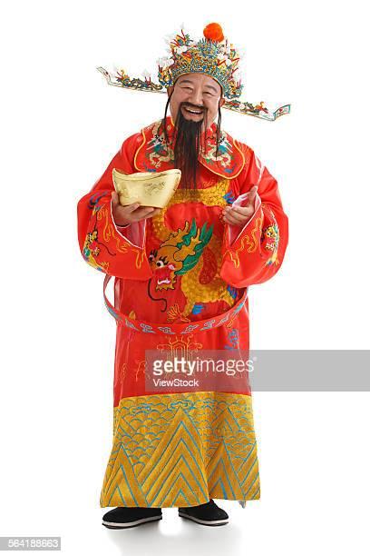 The God of wealth holding gold ingot