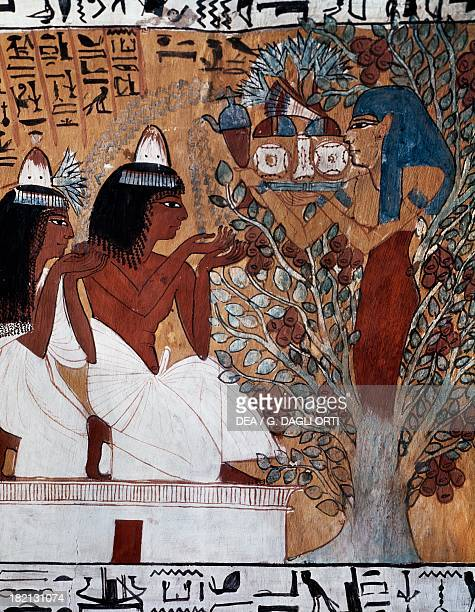 The goddess Isis appearing to Sennedjem and his wife in the sacred sycamore and providing them with water bread and lotus flowers burial chamber...