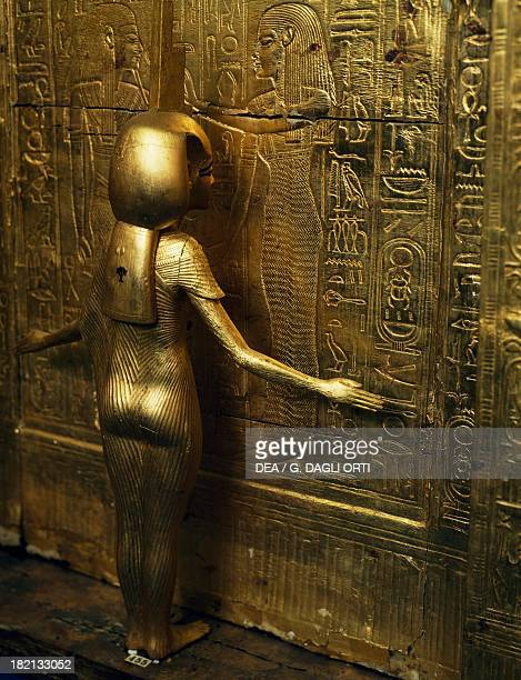 The goddess Isis watching over the young pharaoh detail of a chest of canopic jars gilded wood Tomb of Tutankhamun also known as Tomb KV62 Valley of...