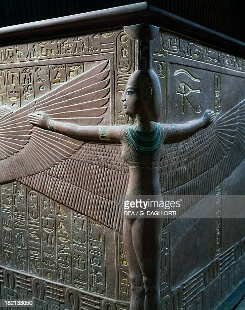 The goddess Nephthys protecting the deceased with outstretched wings detail of the relief decoration of the quartzite sarcophagus Tomb of Tutankhamun...