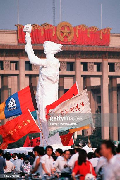 The 'Goddess of Democracy' stands tall amid a huge crowd of flag waving prodemocracy demonstrators in Tiananmen Square in front of the Great Hall of...