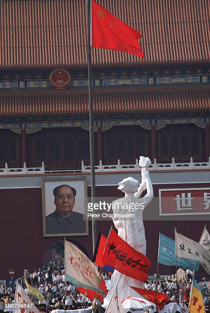 The 'Goddess of Democracy' stands tall amid a huge crowd of flag waving prodemocracy demonstrators in front of the Mao Tse Tung portrait and the...
