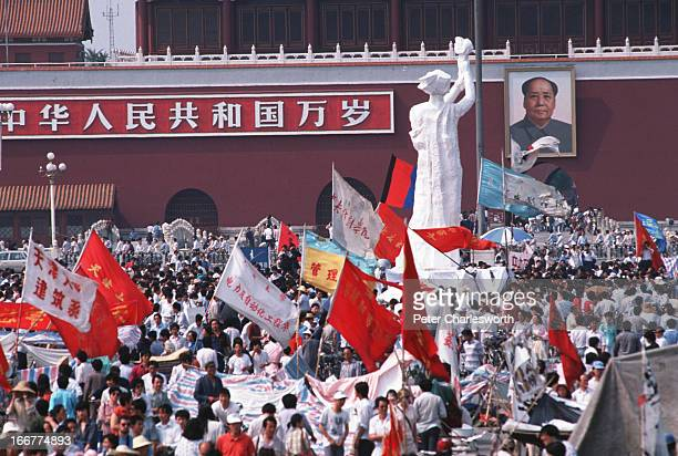 The 'Goddess of Democracy' stands tall amid a huge crowd of flag waving prodemocracy demonstrators in front of the Mao Tse Tung portrait in Tiananmen...