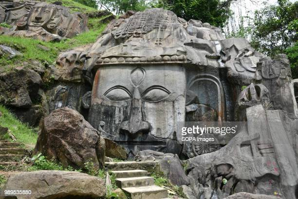 The Godess in the hills of Unokoti seen carved in the rock hosts an ancient Shaivite place of worship with huge rock reliefs celebrating Shiva It is...
