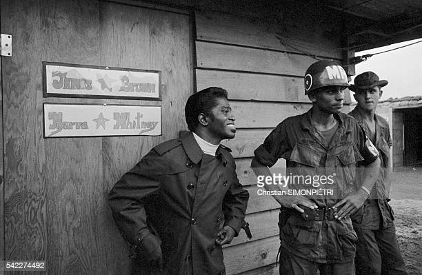 The 'Godfather of Soul' James Brown jokes with troops backstage before performing for American troops during the Vietnam War