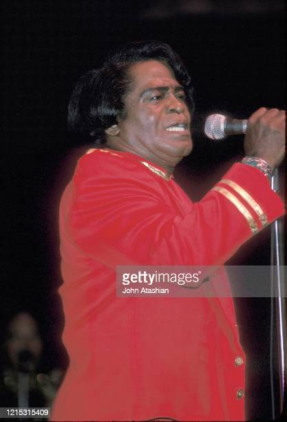 The Godfather of Soul the King of Funk and The Hardest Working Man in Show Business James Brown is shown performing on stage during a live concert...