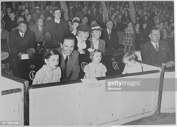 The Goebbels go to the circus. Berlin, Germany: Dr. Joseph Goebbels, fiery German minister of propaganda, is the doting papa in this picture, showing...