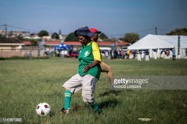 The Gogos from the Mkabadeli Football Club from the Durban township Kwamashu train on an open field on May 7 2019 while the South African opposition...