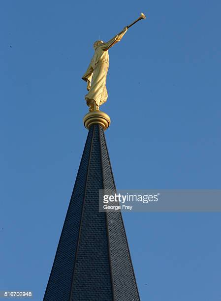 The gold Angle Moroni the symbol of Mormonism sits atop the Provo City Center Temple of the Church of Jesus Christ of Latter Day Saints on March 20...