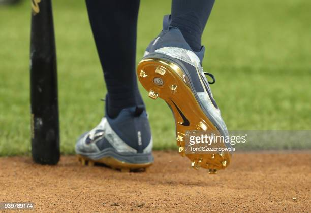 The gold cleats worn by Giancarlo Stanton of the New York Yankees as he walks to the batting cage during batting practice before the start of their...