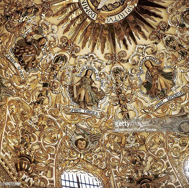 The gold leaf dome of the Chapel of the Rosary, Church of Santo Domingo in Puebla, Mexico - The Chapel of the Rosary was built in 1690, and it is an...