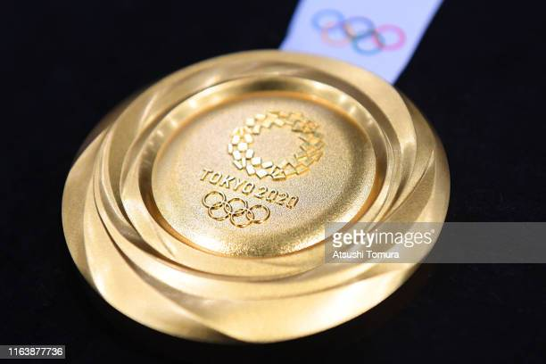 The gold medal is displayed after the Tokyo 2020 medal design unveiling ceremony during Tokyo 2020 Olympic Games One Year To Go ceremony at Tokyo...