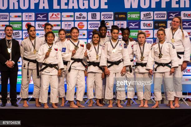 The gold medal winning French team of FLAM 91 JC with their coach were Azzaya Chintogtokh Tabellion Coraline Marcus Penelope Bonna Gabrielle Wuillot...