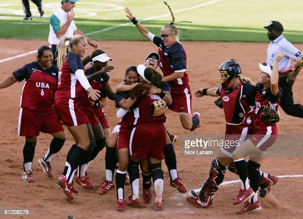 The gold medal winning United States team celebrates after defeating Australia in the softball gold medal contest on August 23 2004 during the Athens...
