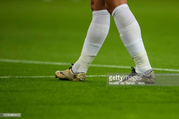 The gold Nike football boots of Harry Kane of England which commemorate him winning the FIFA World Cup Russia golden boot are seen during the UEFA...