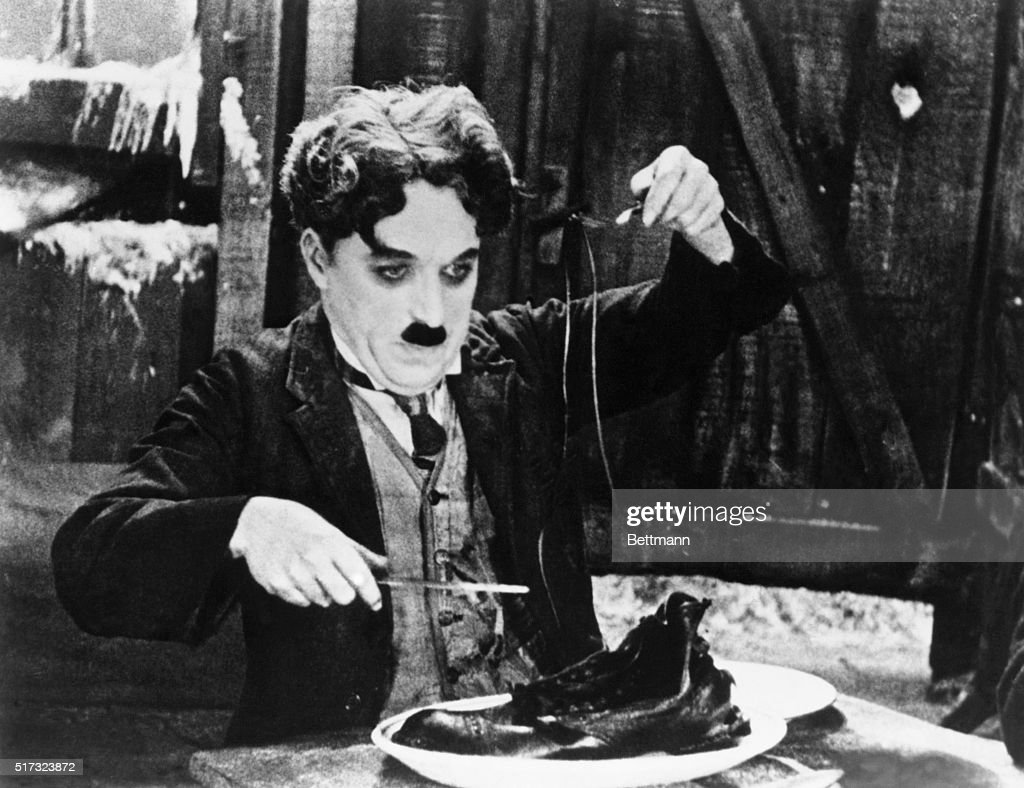 Charlie Chaplin in the Shoe-Eating Scene from The Gold Rush. : News Photo