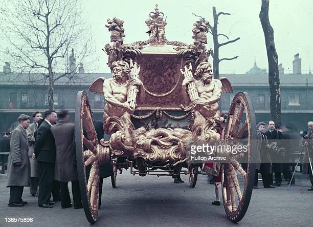 The Gold State Coach used for Queen Elizabeth II's coronation 1953 The carriage built by Samuel Butler dates from 1762 and the tritons on the corners...