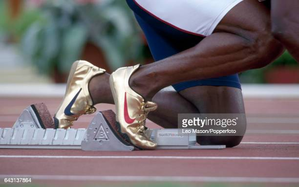 The gold track shoes of Michael Johnson of the USA enroute to winning the men's 200 metres final during the Summer Olympic Games in Atlanta Georgia...