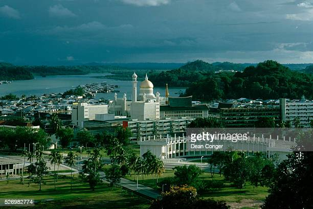 The golddomed Omar Ali Saifuddin Mosque with houses of floating village in foreground The water village built on stilts is called Kampong Ayer The...