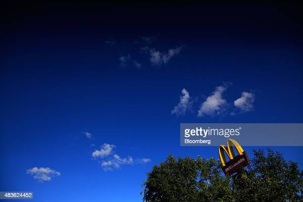 The 'Golden Arches' logo stands outside a McDonald's Corp restaurant in Manchester UK on Monday Aug 10 2015 McDonald's Chief Executive Officer Steve...