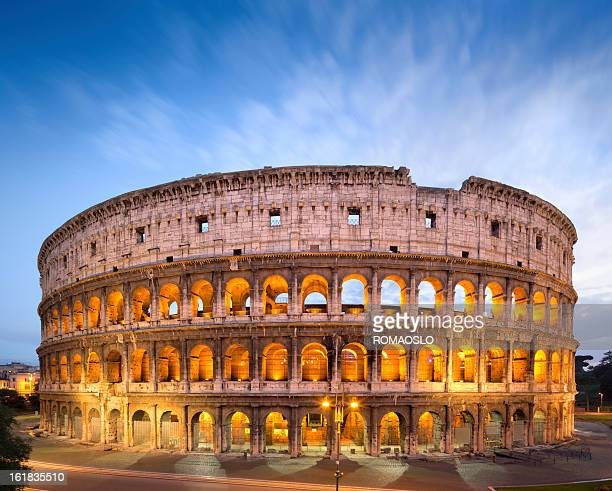 the golden colosseum at dusk in rome, italy  - rome italy stock pictures, royalty-free photos & images
