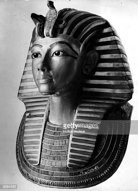 The golden death mask of Egyptian pharaoh Tutankhamen.