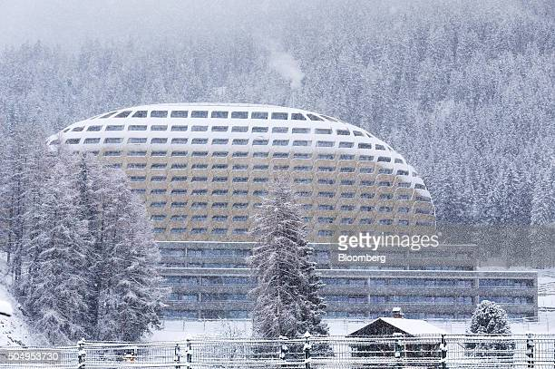 The golden dome of the InterContinental hotel Davos operated by InterContinental Hotels Group Plc stands as snow falls in Davos Switzerland on...