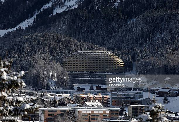 The golden dome of the new InterContinental hotel center operated by InterContinental Hotels Group Plc sits above snow covered buildings in the town...