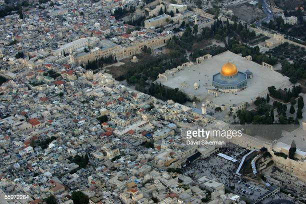 The golden Dome of the Rock Islamic shrine dominates the Temple Mount on which it stands and below it the Western Wall Judaism's holiest shrine...