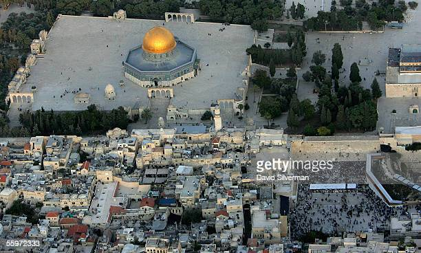 The golden Dome of the Rock Islamic shrine dominates the Temple Mount on which it stands and at right the Western Wall Judaism's holiest shrine...