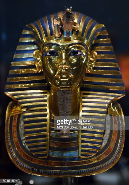 The golden funerary mask of legendary Egyptian boy king Tutankhamun is displayed at the Egyptian Museum in Cairo after its restoration, on December...