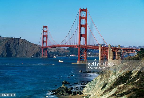 The Golden Gate Bridge 19331937 architect Joseph Baermann Strauss with the Baker Beach in the foreground San Francisco California United States of...