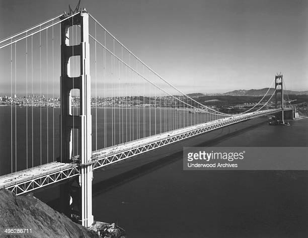 The Golden Gate Bridge getting the last bits of construction done before its opening on May 27 San Francisco California April 1937