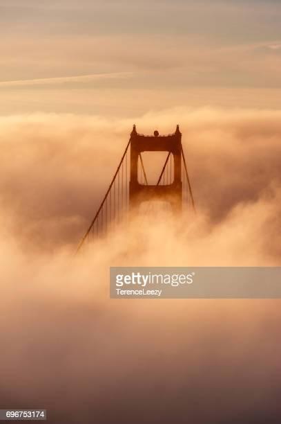 The Golden Gate Bridge, San Francisco, California in the fog at sunrise