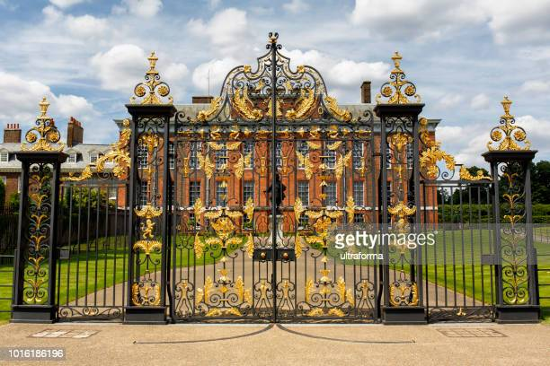 the golden gates of kensington palace in hyde park london - kensington palace stock pictures, royalty-free photos & images