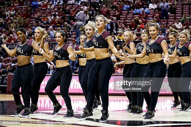 The Golden Girls Dance Team of the Florida State Seminoles performs during a time out at the game against the North Carolina Tar Heels at the Donald...