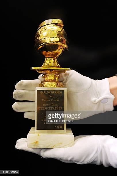 The Golden Globe of Marlon Brando for the Godfather is on display in Beverly Hills California on April 26 2011 Dresses of Lady Diana and items of...
