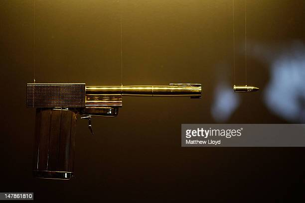 The Golden Gun used by Bond Villian Francisco Scaramanga in 'The Man With The Golden Gun' on display at the Fifty Years of Bond Style press view on...