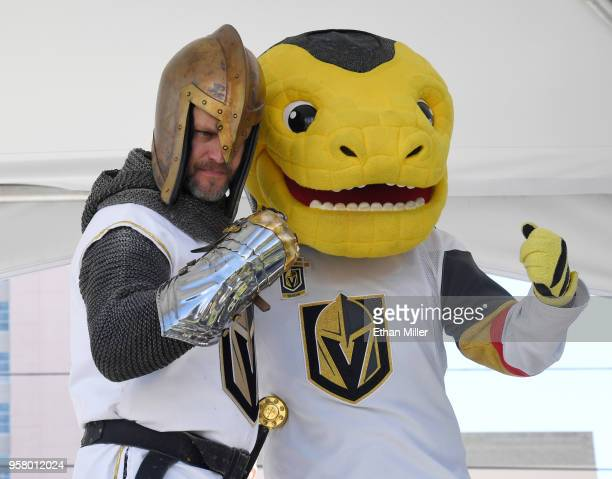 The Golden Knight and the Vegas Golden Knights mascot Chance the Golden Gila Monster pose for photos during a Golden Knights road game watch party at...